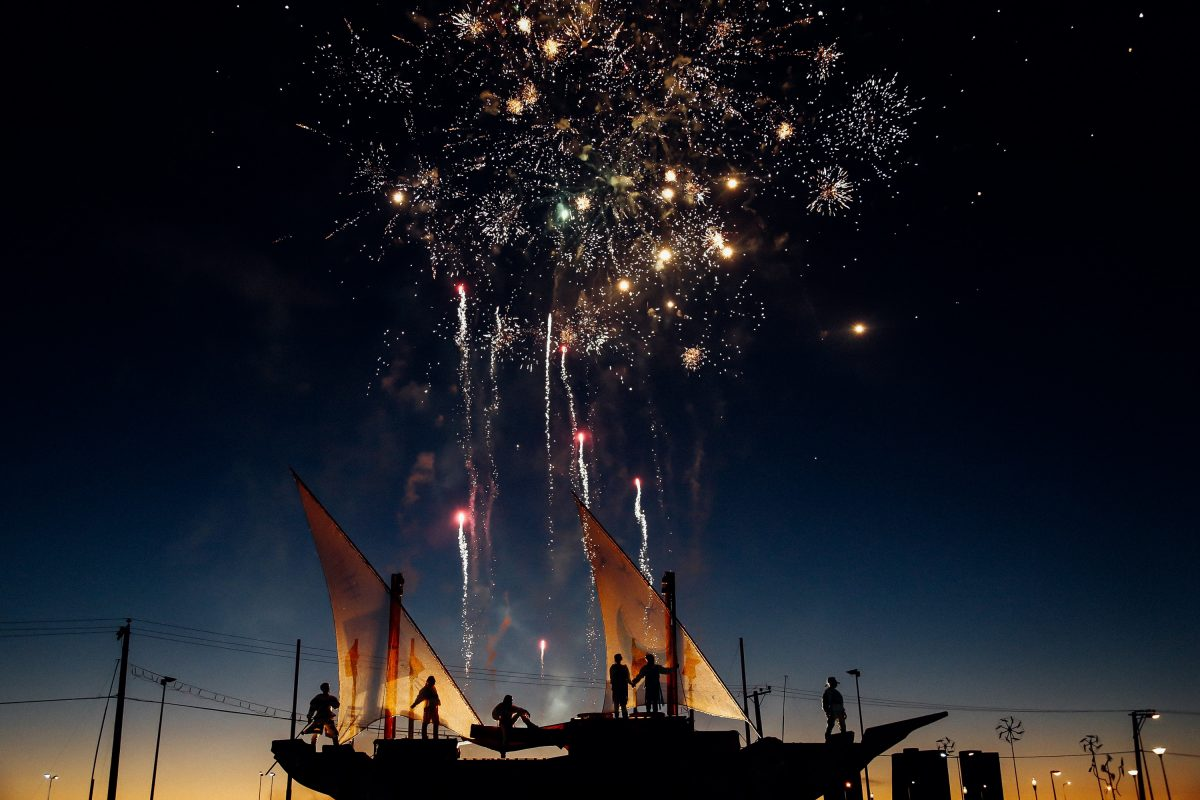 friends scattering ashes firework on a boat